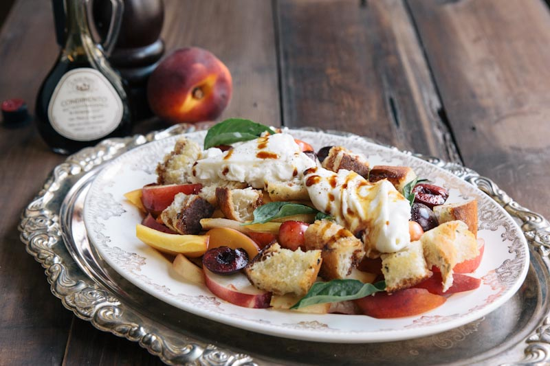 A dreamy summer fruit salad topped with creamy burrata cheese • theVintageMixer.com
