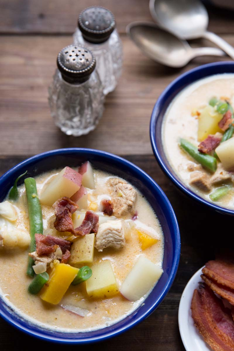 Chicken Corn Chowder Recipe loaded with veggies and a creamy broth • theVintageMixer.com #soup #chowder