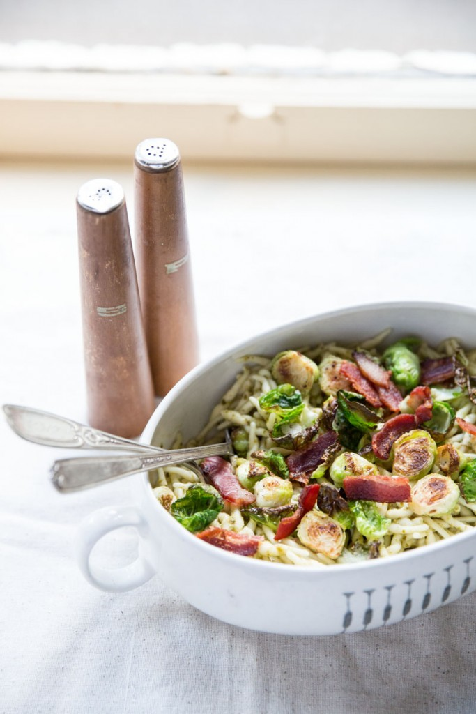 Pesto Trofie Pasta with Brussels Sprout Chips and Bacon • theVintageMixer.com #pasta #brusselssprouts #bacon #eatseasonal