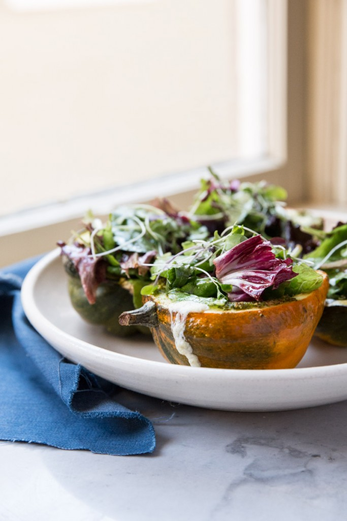 Stuffed Acorn Squash with Burrata Pesto and Greens • theVintageMixer.com #acornsquash #buratta #sidedishrecipe
