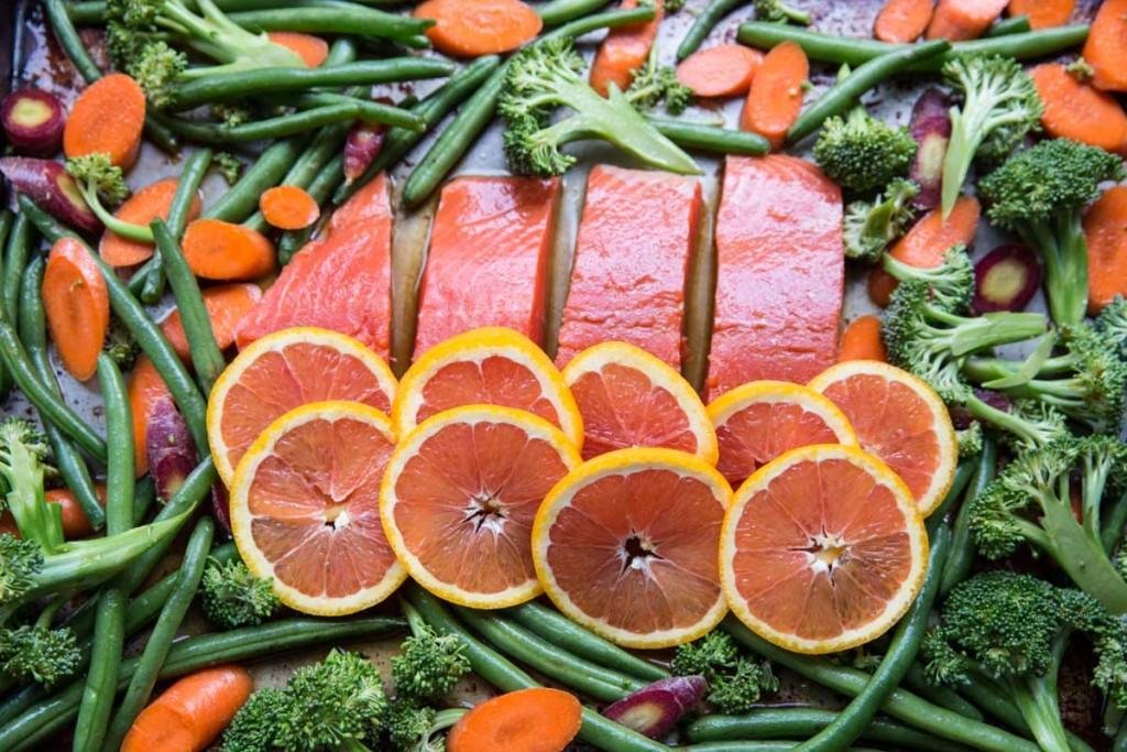 Orange Sesame Sheet Pan Salmon Recipe • theVintageMixer.com #salmonrecipe #sheetpanrecipe #easyrecipe #healthyrecipe #glutenfree #dairyfree #myharmons