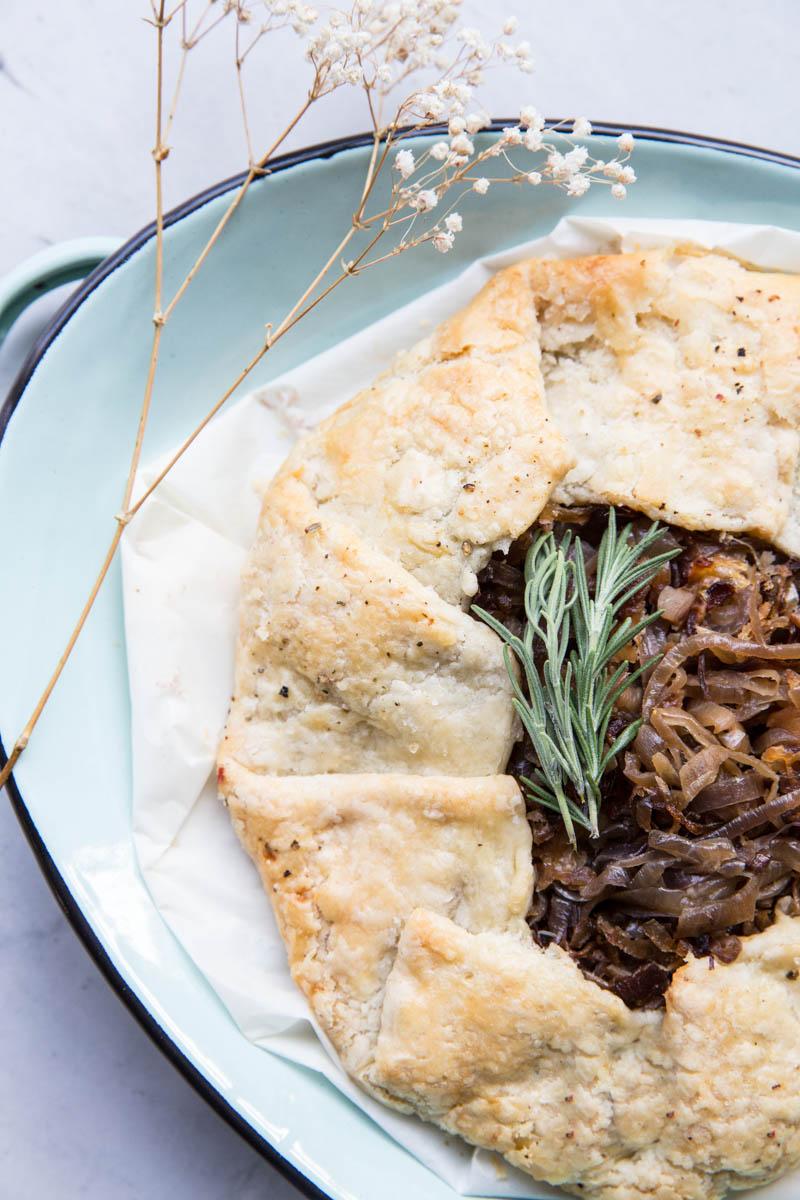 This savory tart or galette filled with caramelized onions is a great party appetizer.