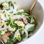 Mushroom Arugula Pasta Salad Recipe • theVintageMixer.com #pastasalad #mushrooms #eatseasonal #cleaneating