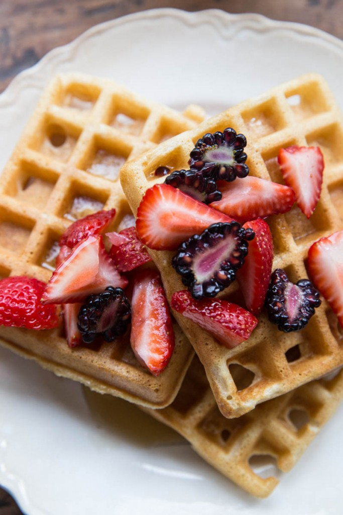 Simple Whole Wheat Waffles served with fresh berries and pure maple syrup
