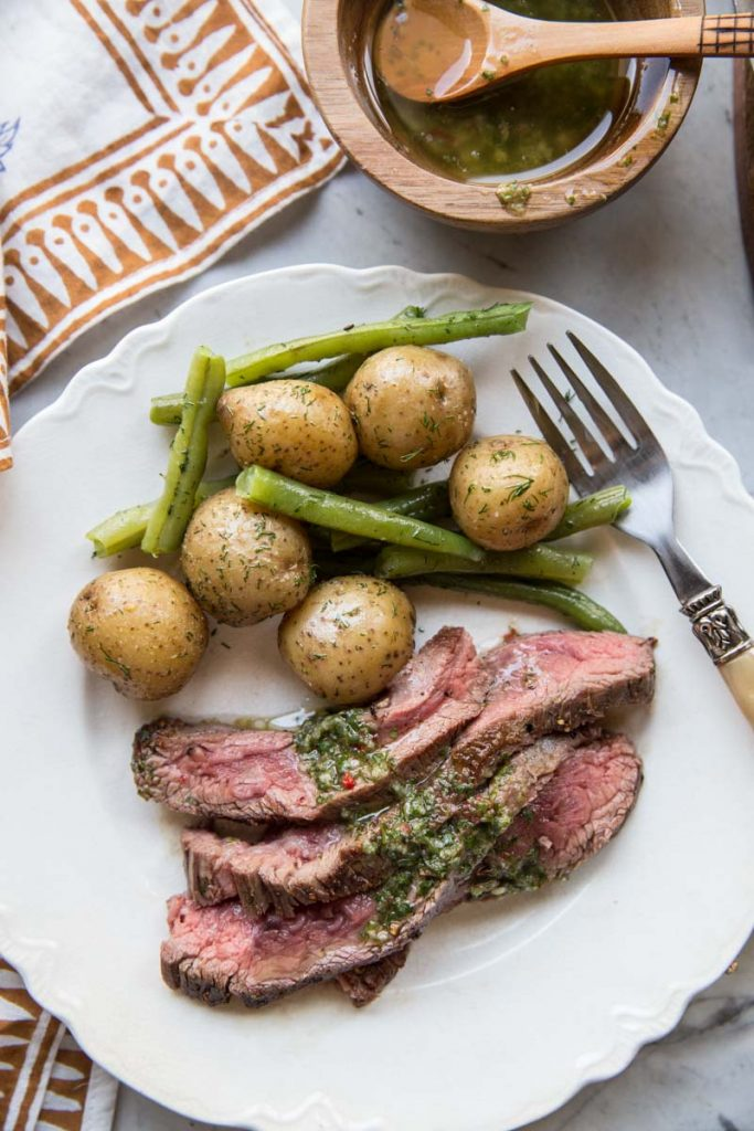 Here's a simple Summer meal of that's fool-proof, Flank Steak with Chimichurri.