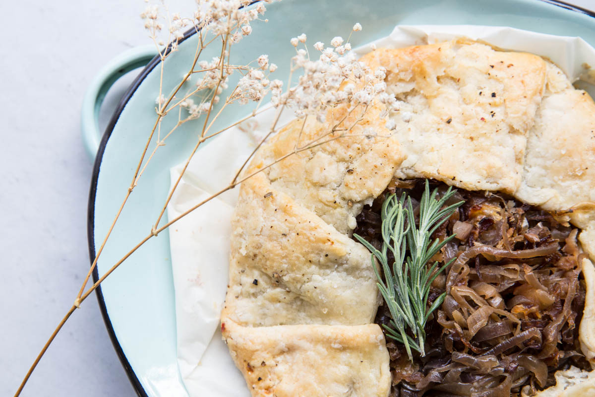 This savory Caramelized Onion Galette makes for a perfect appetizer or summer meal alongside a green salad.