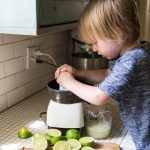 Kids are great help when it comes to fresh squeezed juice!