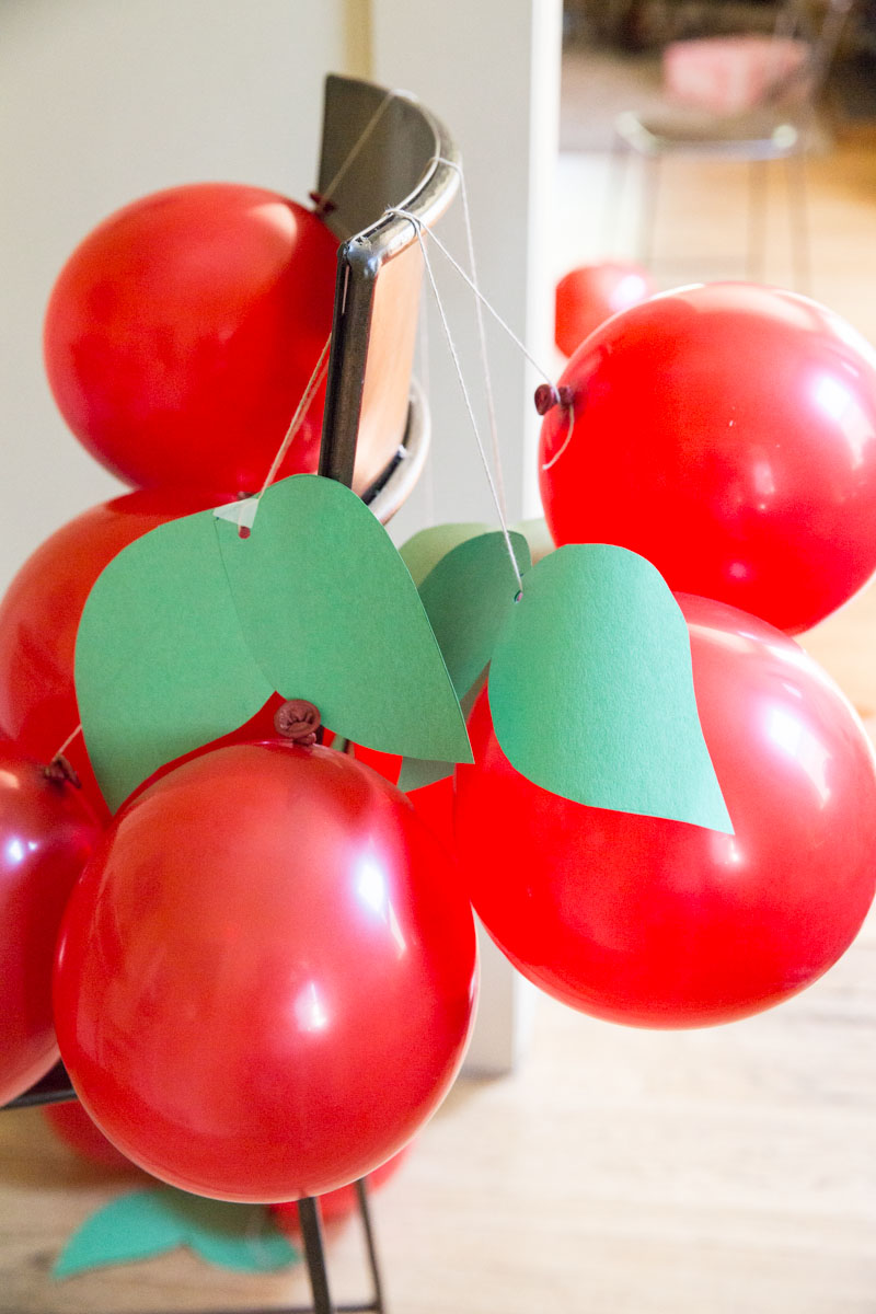 Make these cherry balloons with contact paper and red balloons for a cherry themed party.