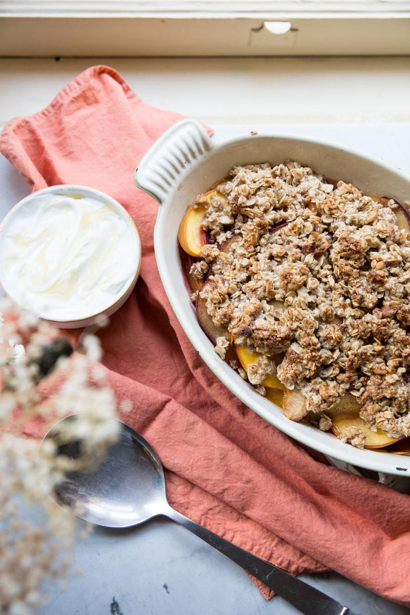 This Peach Crisp is topped with oats and nuts for a perfectly healthy and gluten free breakfast or dessert.