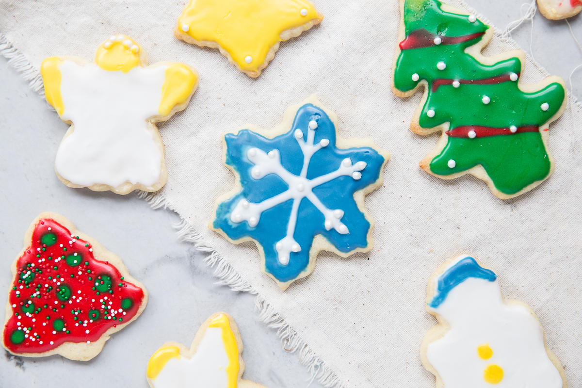 This is the BEST recipe for Christmas Cut Out Sugar Cookies! They don't spread when you bake them and the frosting dries flat.
