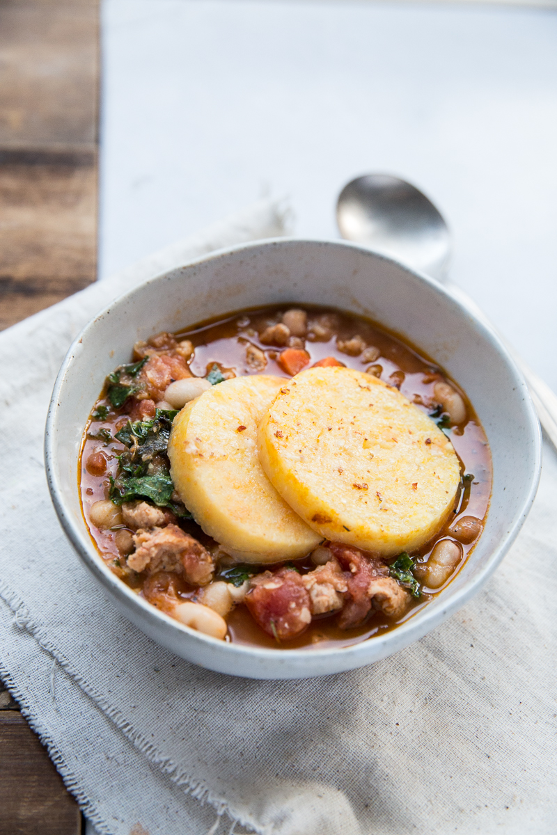 Here's a heart winter dinner recipe that the whole family will love and it's gluten free! Sausage, White Bean and Kale Cassoulet with Polenta.
