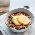 This is the ultimate Winter meal with sausage, white beans and kale, topped with crispy polenta.