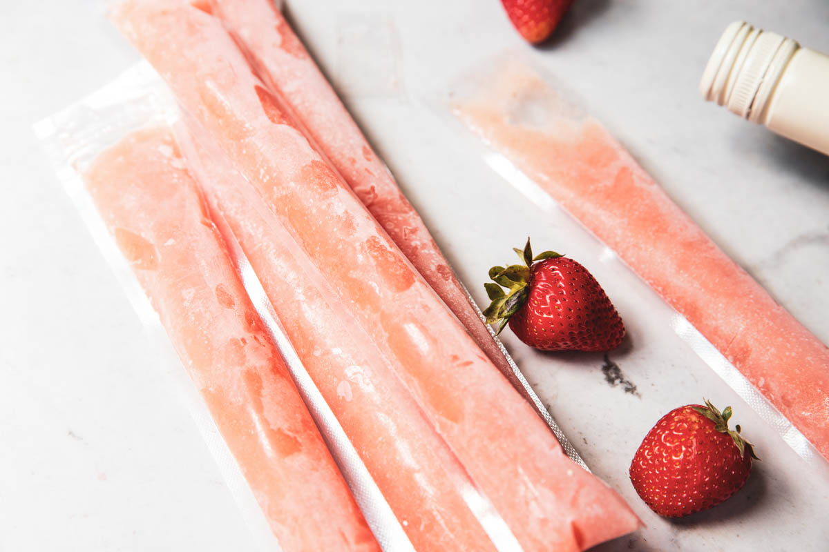 These Homemade Rosé wine popsicles only take 10 minutes to make and will be the hit of any party.