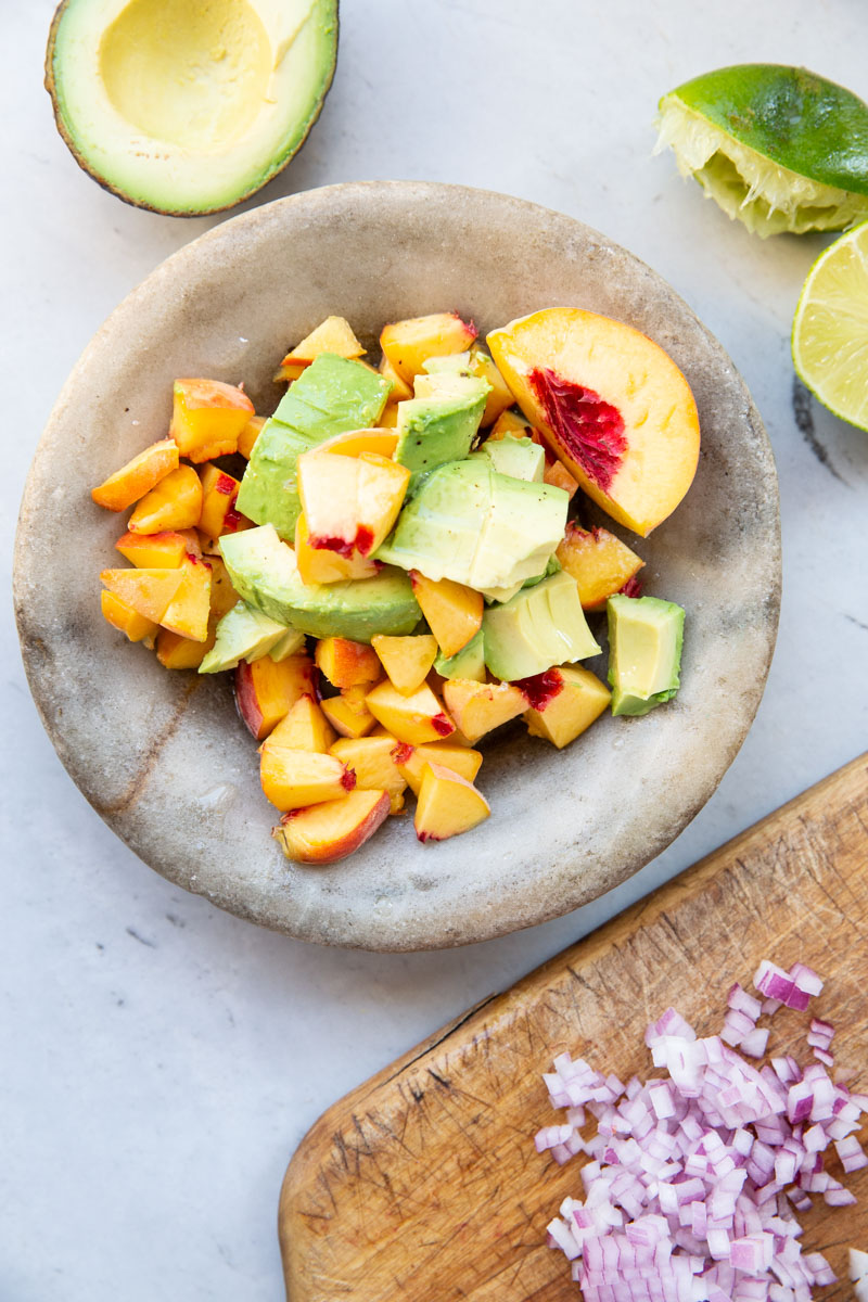 An easy recipe for peach and avocado salsa that goes great with just about any Mexican dish.